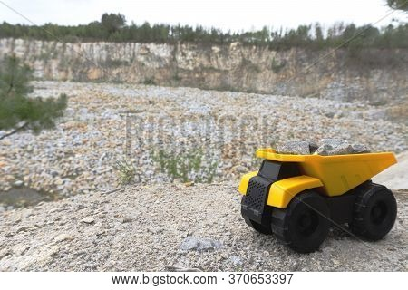 Mining Industry. Dump Truck With Stones At The Background Of Quarry.