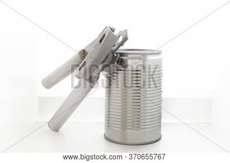 The Can Opener Opens Can Isolated On A White Background