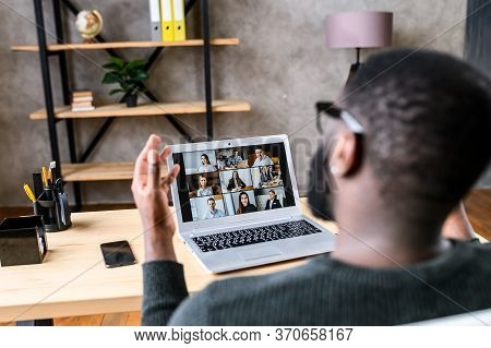 Confident African-american Male Worker Talking Online With Coworkers, Back View Of Black Guy Speaks