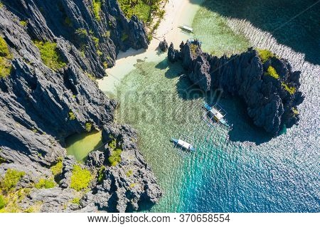 El Nido, Palawan, Philippines, Aerial View Of Boats And Cliffs Rocky Mountains Scenery At Secret Lag