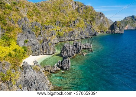 El Nido, Palawan Island. Hidden Lagoon And Lime Stone Rocks. Rocky Formations On Famous Tropical Bea