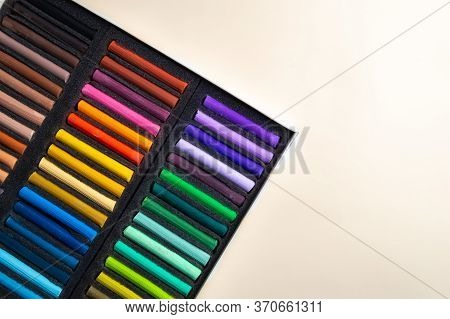 Crayons For Drawing In A Box On A White Background. Dry Pastels For Artists.