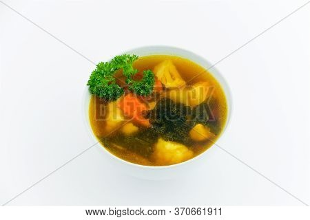 Cup With Food On A White Plate, Traditional Japanese Miso Soup, Vegetarian Dill Seaweed Soup, Tasty