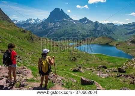Two Hiker Women In Path Of Pic Du Midi Ossau In The French Pyrenees Mountains