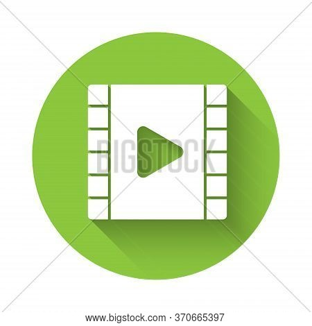 White Play Video Icon Isolated With Long Shadow. Film Strip With Play Sign. Green Circle Button. Vec