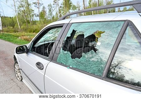 Car With Shattered Glas Windows In Sweden