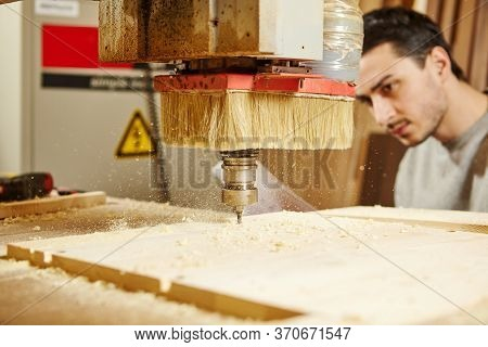 Machine With Numerical Control Cuts Wood. Cnc Device In The Carpentry Shop.