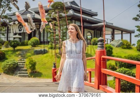 Traveler Stopped On The Street And Looking At The Japanese Traditional Building. Japan Travel Touris