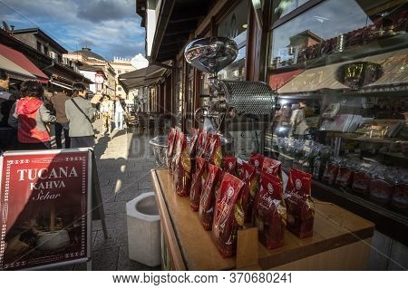 Sarajevo, Bosnia - April 17, 2017: Bosnian Coffee Packs, Near A Roaster And A Grinder, Ready To Be S