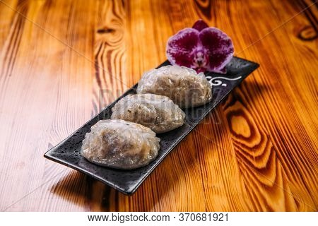 Side View On Korean Patties Starchy Pyan-se Pygody On The Wooden Table, Horizontal