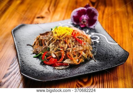 Appetizing Korean Salad Funchoza With Beef Starch Noodles And Vegetables, Horizontal