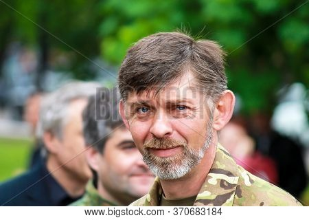 Dnipro City, Ukraine, 9 05 1918. A Man In Military Uniform Smiles At A Holiday. Military Man On A Ci