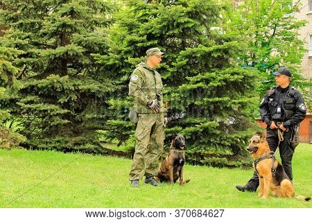 Dnipro City , Dnepropetrovsk, Ukraine, May 9, 2018. Ukrainian Police Dog Handlers With Trained Sheph