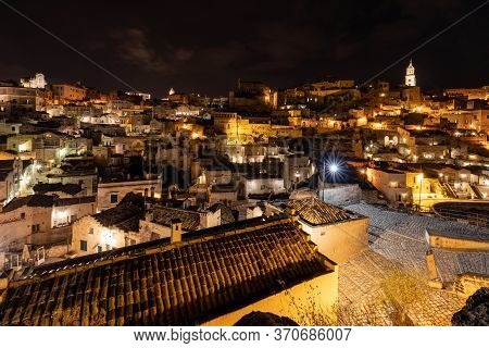 Night Landscape Of The Sassi Of Matera, Well-known For Their Ancient Cave Dwellings. Basilicata. Ita