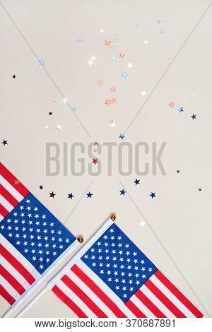 Festive Background With Us Flags And Confetti In The Shape Of Stars. Us Independence Day Concept.