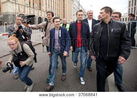 MOSCOW - 15 SEPTEMBER: Opposition leaders Ilya Yashin (L) and Alexei Navalny (R) speaks at a anti-Putin protest rally in central Moscow, on September 15, 2012 in Moscow.