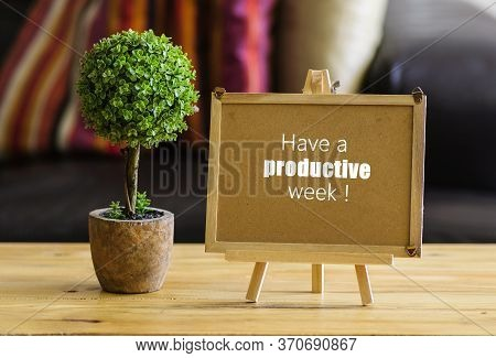 Image Of Motivational Greeting Have A Productive Week On Brown Mini Notice Board. Besides A Decorati