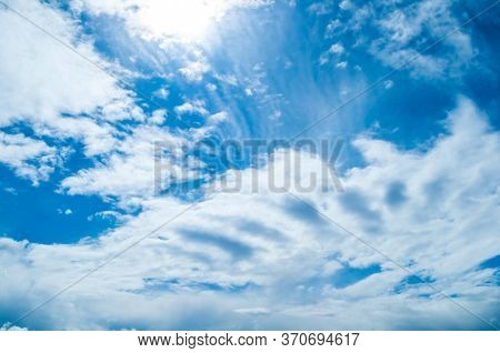 Blue sky background, vast blue sky landscape panoramic scene. Colorful blue sky view in bright tones, vast sky landscape, sky nature, sky scene. Sky background with white clouds. Sky colorful view
