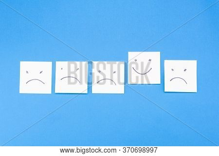 Many Stickers - Negative And Positive Emoticon On A Blue Background