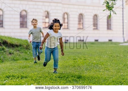 Kids Playing In Summer City Park.children Play Outdoors On A Sunny Spring Day.blond Boy, Cute Hispan