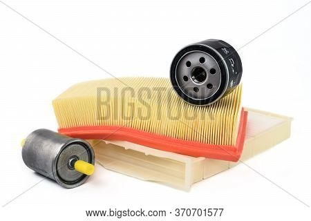 Spare Parts For Car. Oil Filter, Air Filter, Fuel Filter And Cabin Filter On A White Background.