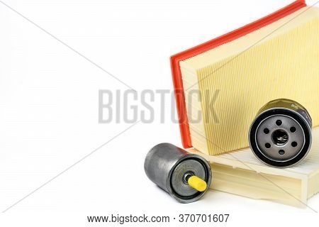 Spare Parts For Car. Oil Filter, Air Filter, Fuel Filter And Cabin Filter On A White Background With