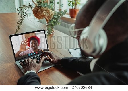 Businessman Participate Video Conference Looking At Laptop Screen During Virtual Meeting, Videocall