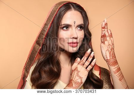 Mehndi. Portrait Of Beautiful Girl In Saree Isolated On Beige. Young Hindu Woman Model With Kundan G