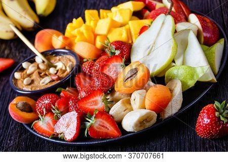 Rainbow Fruit Platter Of Fresh Fruits And Berries With Peanut Dip: Strawberries, Tropical Mango, Ban