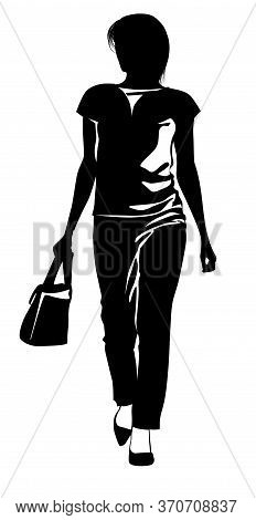 Silhouette Of A Girl In Trousers Walking With A Handbag In Hand