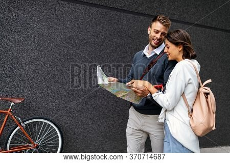 Holidays, Dating And Tourism Concept. Smiling Couple In Love With Map In The City