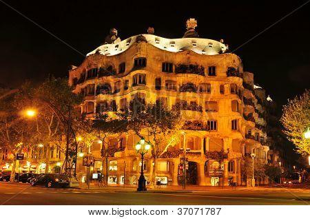 BARCELONA, SPAIN - SEPTEMBER 10: Casa Mila, or La Pedrera, at night on September 10, 2012 in Barcelona, Spain. This famous building, placed in Passeig de Gracia, was designed by Antoni Gaudi