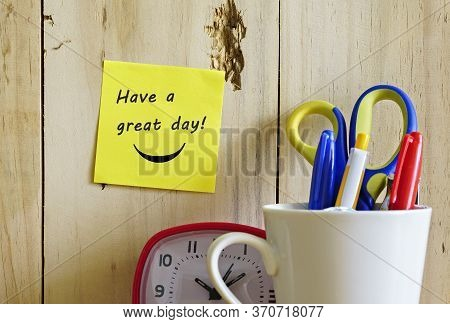 Image Of Motivational Greeting Have A Great Day On Brown Mini Notice Board. Besides A Decorative Gre