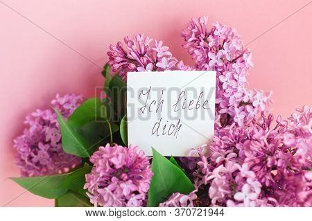 The Inscription I Love You In German And A Beautiful Spring Bouquet Of Lilac Flowers