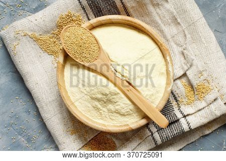 Bowl Of Raw Amaranth Flour With A Spoon Of Amaranth Seeds Top View