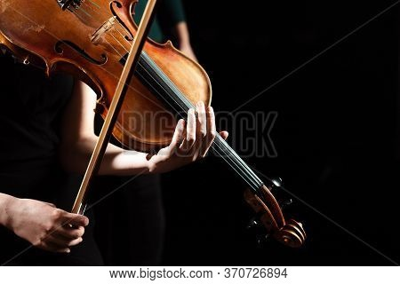 View Of Female Musician Performing Symphony On Violin Isolated On Black