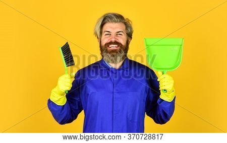 In Good Mood. Mature Male Worker With Broom Cleaning. Male Janitor Cleaning With Broom. Man Cleaning