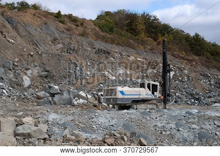 Drilling Rig Prepares Blasting Operations In A Stone Quarry
