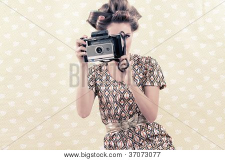 Woman taking photograph from vintage 4x6 film camera .