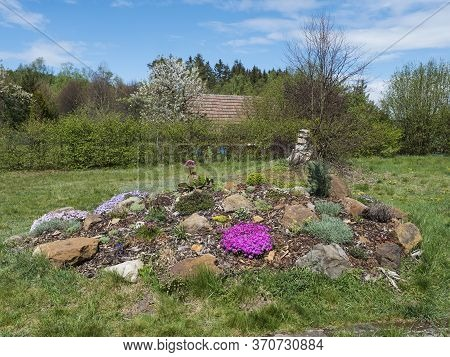 View On Spring Garden With Beautiful Rock Garden In Full Bloom With Pink Phlox Subulata, Armeria Mar