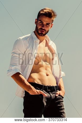 Attractive Torso. Hot Day Outdoors. Attractive Man Taking Off Shirt. Confident In His Appealing. Bea