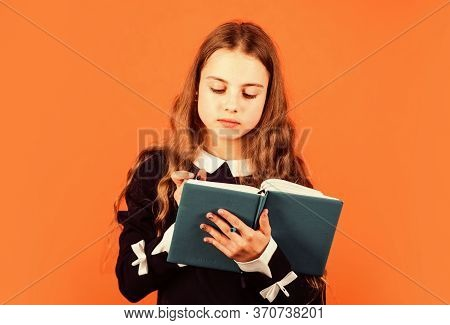 Read Me Story. Little Girl Read And Write Brown Background. Learn How To Read Book. School And Educa