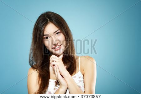beautiful cute happy smiling teen girl portrait over blue background