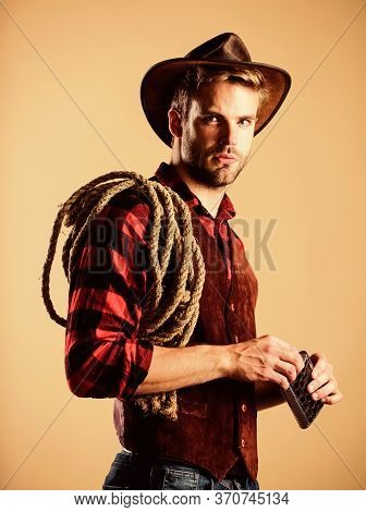 Have A Drink. Wild West Rodeo. Man In Hat Drink Whiskey. Man Checkered Shirt On Ranch. Cowboy With L