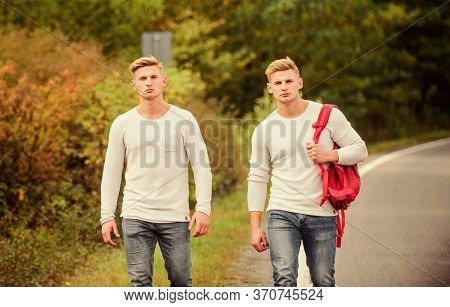 Cheap Travel. Friendship Concept. Men Hitch Hiking. Man Casual Style Travel With Backpack. Traveler