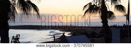 Sunset At Beach And Atlantic Ocean Panorama In Holiday Resort Playa De Las Americas On Canary Island