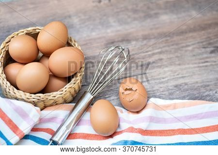 Pile Of Organic Fresh And Raw Hen Chicken Eggs In A Bowl And Whisk To Cooking Bakery.agriculture Far