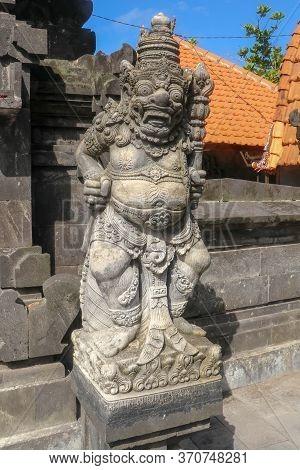 Closeup Of Stone Statue In Temple Batu Bolong Near To Tanah Lot In Bali, Indonesia. A Carved Statue