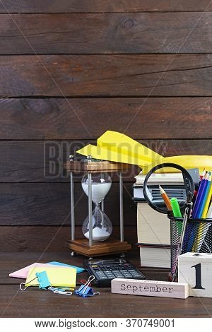 Different School Supplies On Wooden Background. Concept Back To School