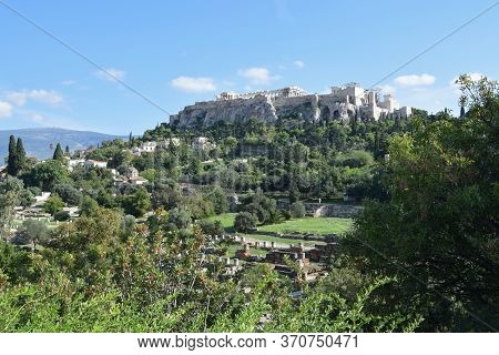 Athens, Greece - October 14, 2015: Acropolis Rock And Temple Of Parthenon As Seen From The Archaeolo